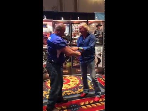Omega Force Strong Man pulls sword from Sword Swallower Dan Meyer at IAFE 2014